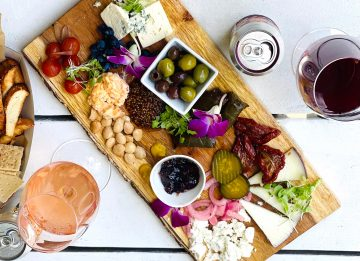 cheeseboard with cheese, crackers and olives